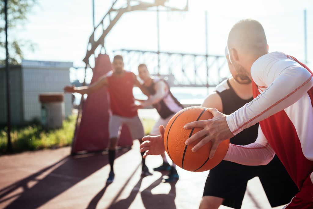 Man passing the basketball to another player.